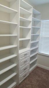white custom walk in closet